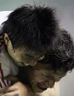 图文:中国2-0哥斯达黎加 谢晖与队友孙祥庆祝