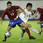 图文:中国2-0哥斯达黎加 李金羽与对手拼抢