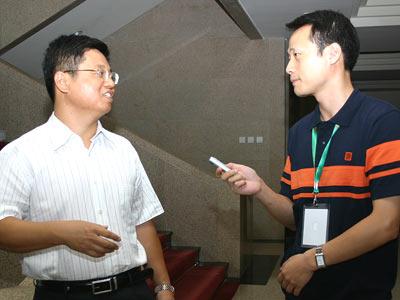 谢剑采访国家税务总局法规司副司长李万甫
