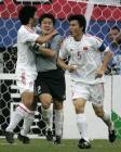 图文:中国战平韩国 李雷雷扑住对方点球