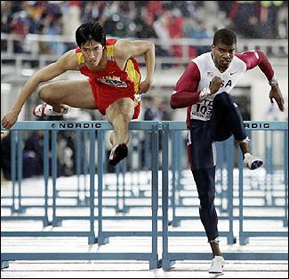 图文:世锦赛男子110米栏 刘翔13秒42顺利晋级