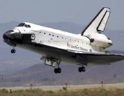 Discovery to take another try at landing