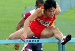 图文:世锦赛男子110米栏 刘翔比赛中英姿