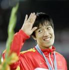 图文:世锦赛男子110米栏 刘翔笑对镜头