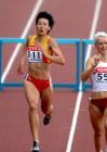 图文:黄潇潇获女子400米栏第五名 冲向终点