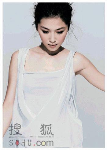 周丽淇新专辑显纯情 回忆初吻拍感性照片(图)