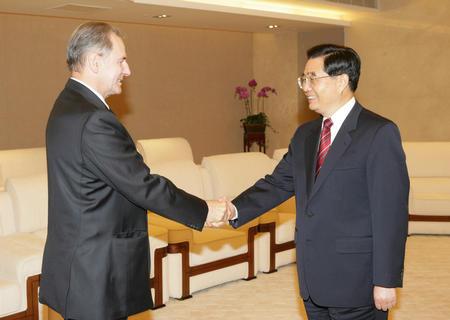 图文:胡锦涛会见国际奥委会主席罗格