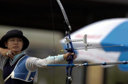 赛艇:十运射箭比赛北京队踏板钟华光阳螺丝机油摩托车图文放油选手图片