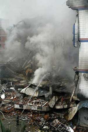 深圳打工仔被工厂处分 怀恨在心纵火烧塌厂房(图)