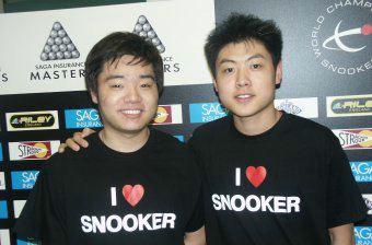 搜狐体育讯 由于在前面的资格赛上失利,中国的台球高手--丁俊晖和梁图片