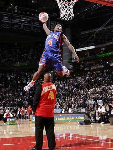 NBA图:全明星扣篮大赛 罗宾逊惊人的一跳