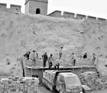 国家文物局指导平遥古长城修复 工程需上亿资金