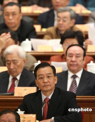 图:温家宝出席全国政协十届四次会议闭幕式