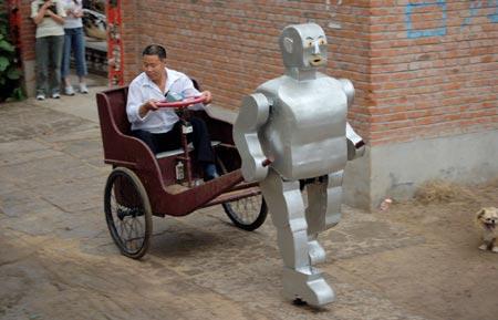 北京农民发明拉黄包车机器人 (图)