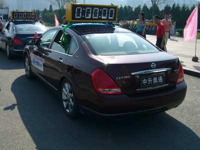 天籁成为大连国际马拉松大赛服务用车/图