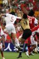 图文:亚洲杯预选赛中国VS新加坡 李玮峰抢点