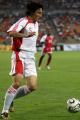 图文:亚洲杯预选赛中国VS新加坡 李玮峰助攻