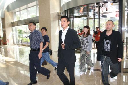 图文:蒋效愚接见刘德华 华仔表示08一定来北京
