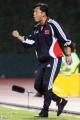 图文:亚少赛中国1-2朝鲜 郑雄指挥比赛