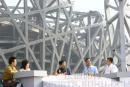 图文:鸟巢实施钢结构卸载 现场嘉宾谈设计方案