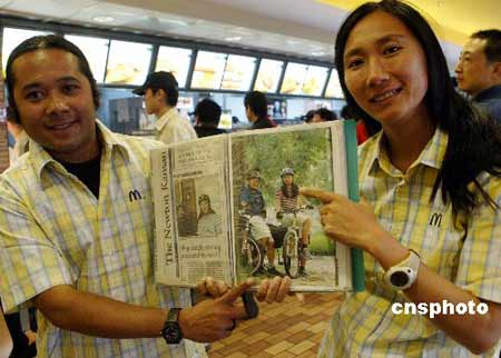 泰国夫妇自行车蜜月旅行5年抵京(组图)