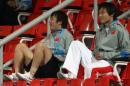 图文:亚运女足赛中国7-0泰国 郜林为女足加油