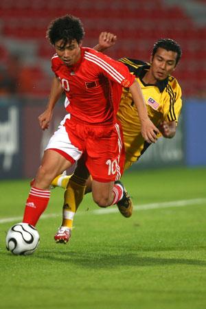 图文:中国国奥3-1战胜马来西亚 陈涛突破进攻