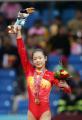 图文:亚运体操女子跳马比赛 程菲向观众致意