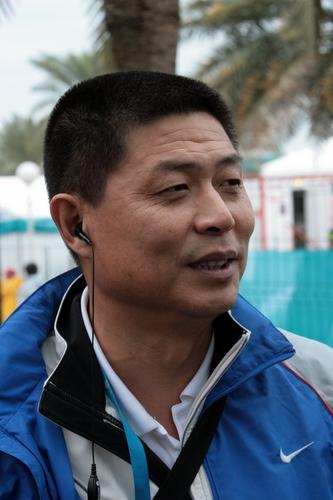 图文:20km竞走韩玉成夺冠 田径队总教练冯树勇