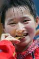 图文:女子跆拳道47公斤级 品尝金牌味道