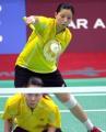 图文:亚运会羽毛球女双决赛 杨维张洁雯在比赛