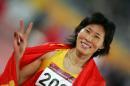 图文:亚运女子400米栏决赛 黄潇潇的胜利手势