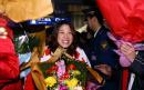 图文:亚运健儿凯旋 高��步出首都国际机场