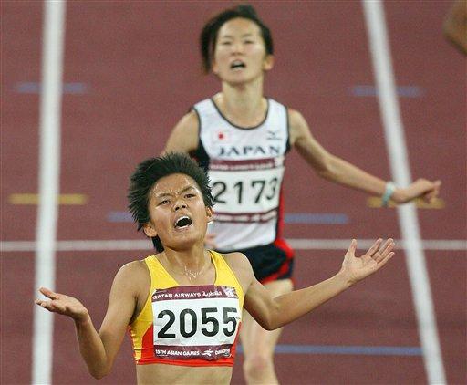 田径-薛飞后程发力超日本名将 女子5000米夺金