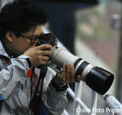 图文:李婷/郭晶晶3米板夺冠 霍启刚到场观战