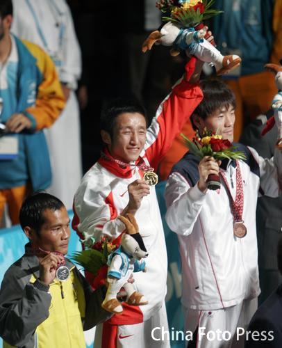 邹市明完胜泰国名将 夺中国拳击16年来亚运首金