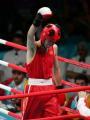 图文:亚运会男子拳击60公斤级 胡青庆祝胜利