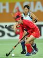 图文:中国女曲卫冕亚运冠军 中国球员带球进攻