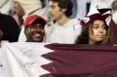图文:卡塔尔男足夺得亚运冠军 球迷庆祝胜利