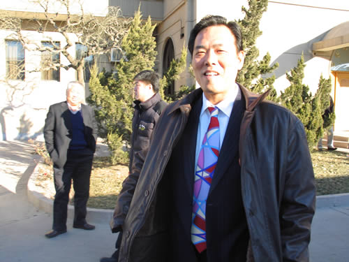 图文:中国亚运代表团返京 蔡振华春风满面
