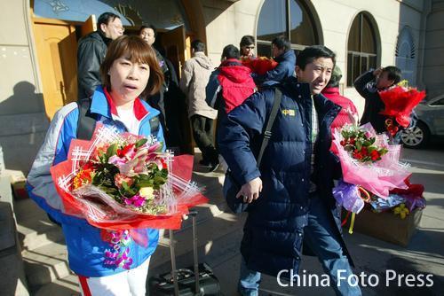 图文:中国亚运代表团抵京 曲棍球教练金昶伯