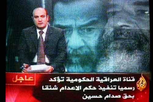 伊拉克电视台宣布萨达姆被绞死 播放爱国音乐