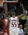 NBA图:常规赛火箭胜湖人 穆大叔盖帽后的酷姿