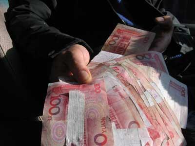 储户取16张百元残币 北京银行无法证实残币出处