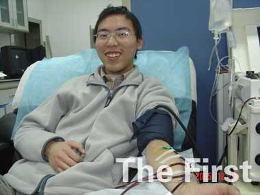 北京男孩儿薛祺志愿服务已超过700小时(图)