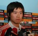 图文:国足结束拉练返回北京 肇俊哲好不严肃