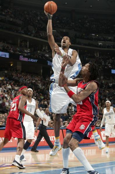 NBA图:掘金负网 坎比强攻