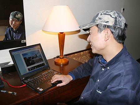 奚志农:北京奥运是环保契机 用摄影保护自然