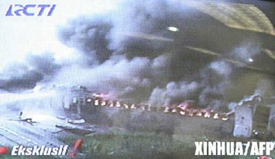 印尼客机着陆时起火 至少49人死亡