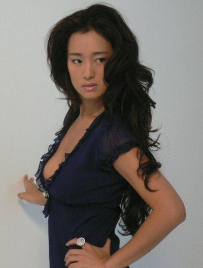 首届亚洲电影大奖最佳女演员提名:巩俐简介